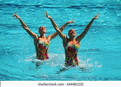 RIO DE JANEIRO, BRAZIL - AUGUST 15, 2016: Lolita Ananasova and Anna Voloshyna of Ukraine compete during synchronized swimming duets free routine preliminary of the Rio 2016 Olympic Games