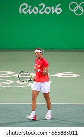 RIO DE JANEIRO, BRAZIL - AUGUST 9, 2016: Olympic champion Rafael Nadal of Spain in action during men's doubles round 3 of the Rio 2016 Olympic Games at the Olympic Tennis Centre