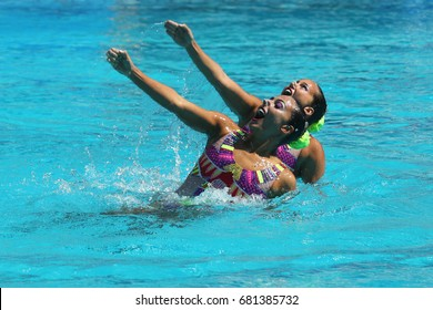 RIO DE JANEIRO, BRAZIL - AUGUST 14, 2016: Alvarez Piedrahita and Arango Estrada  of Colombia compete during the synchronized swimming duet free routine preliminary round at the 2016 Summer Olympics