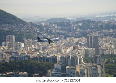 Rio de Janeiro, Brazil - August, 2017 Comercial plane fly over city and prepare to land in Rio de Janeiro.