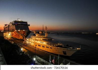 Rio de Janeiro, Brazil, August 13, 2016: Sunset seen at the Port of Rio. In background the 326-meter Norwegian Transatlantic Norwegian Getaway, the 9th largest Transatlantic ship in the world