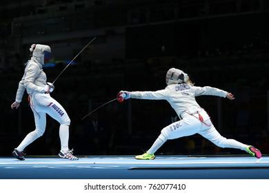 RIO DE JANEIRO, BRAZIL - AUGUST 13, 2016: Dagmara Wozniak of United States (R) and Ekaterina Dyachenko of Russia compete in the Women's Sabre Team of the Rio 2016 Olympic Games at Carioca Arena 3