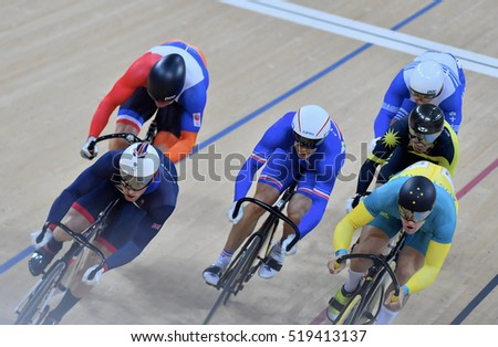 Rio de Janeiro, Brazil - August 17, 2016: Cycling Athlete bike while fight competing in Keirin Finals, at Rio Olympic Velodrome, Olympic Games 2016 Rio De Janeiro, Brazil.