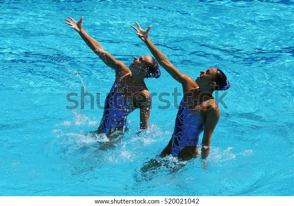 RIO DE JANEIRO, BRAZIL - AUGUST 14, 2016: Anita Alvarez and Mariya Koroleva of team United States compete during synchronized swimming duets free routine preliminary of the Rio 2016 Olympic Games