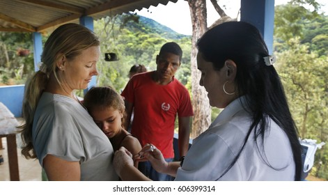 Rio de Janeiro, Brazil- Casimiro de Abreu, March 17th, 2017- A Brazilian nurse vaccinate farmer Viviane, as her mother Sueli Klein holds on after the dead of a man infected by yellow fever.