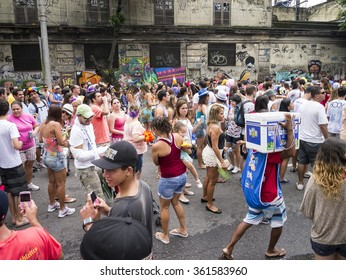 RIO DE JANEIRO, BRAZIL - CIRCA JANUARY, 2013: Crowds fill the street celebrating carnival in a bloco street party in the Jardim Botanico neighborhood.