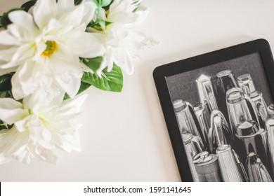 Rio de Janeiro, Rio de Janeiro, Brazil - December 17, 2019: eReader Kindle Paperwhite with a flowers and withe background. reader and zero waste concept