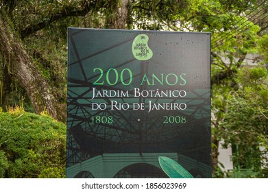Rio de Janeiro, Brazil - December 26, 2008: Botanical Garden or Jardim Botanico. Artful poster celebrating 200 years aniversary. Different shades of green white white on black. Green foliage in back.