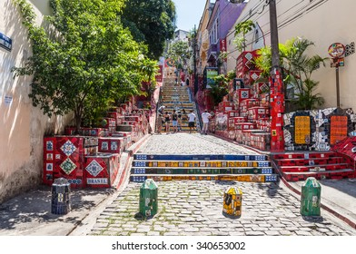 RIO DE JANEIRO, BRAZIL - DECEMBER 21, 2012: Tourists visiting the Selaron stairway in Rio de Janeiro, Brazil. The stairway is famous work of Chilean artist Jorge Selaron.