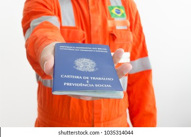 Rio de Janeiro, Brazil - February 28 2018: Unemployed worker looking for a a new job show his work permit document from Brazil (job wallet)