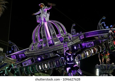 Rio de Janeiro, Brazil-  February 22, 2018-  a samba dancer fancy dressed performs atop a float representing a sattelite during the annual samba school parade.