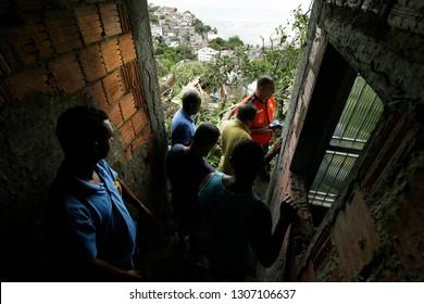 Rio de Janeiro, Brazil  February, 07th, 2019  Residents of Barra de Guaratiba shantytown observes a land slide beside a house where 2 people dead