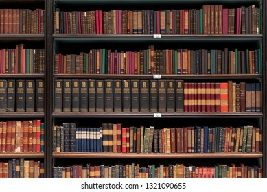 Rio de Janeiro, Brazil - February 19, 2019: Antique books on shelves of Royal Portuguese Cabinet of Reading.