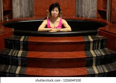 Rio de Janeiro, Brazil   February 27th, 2019   Japanese plastic artist Yuko Haegawa poses in a marble bath during a press conference