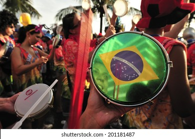 RIO DE JANEIRO, BRAZIL - FEBRUARY 08, 2013: Street Carnival in Rio de Janeiro, crowd of people celebrate on the street with Blocos, individual groups who plan the parties with bands and samba music.