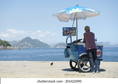 RIO DE JANEIRO, BRAZIL - FEBRUARY 11, 2014: Brazilian beach vendor selling ice cream stands at the entrance to Red Beach in Urca.