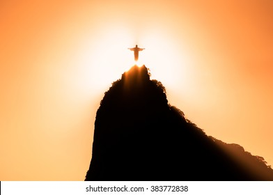 RIO DE JANEIRO, BRAZIL - FEBRUARY 2, 2016: Sun goes down right behind Christ the Redeemer statue on Corcovado mountain in Rio de Janeiro.