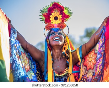 Rio de Janeiro, Brazil - February 9: Beautiful Brazilian woman of African descent wearing colorful costume and smiling during Carnaval street parade in Rio de Janeiro, Brazil.