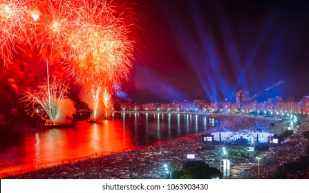 Rio de Janeiro, Brazil - Jan 1st, 2018: Revellers, both locals and tourist, enjoy the breath-taking New Years fireworks display along Copacabana Beach, Rio de Janeiro, Brazil