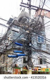 RIO DE JANEIRO, BRAZIL - JAN 29: Mess of wires in favela Rocinha in Rio de Janeiro, Brazil