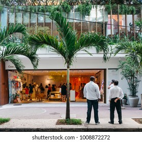Rio de Janeiro, Brazil - January 10, 2018: Street scene of an open shop in Ipanema selling sandals and women's clothes, including bikinis. Sandalias means sandals in Portuguese