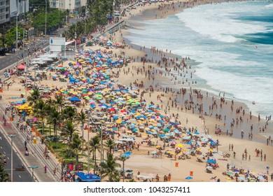 RIO DE JANEIRO, BRAZIL - JANUARY 2018 : Crowded Ipanema Beach full of people on sunny carnival day. Ipanema is most trendy beach in Rio de Janeiro