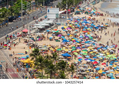 RIO DE JANEIRO, BRAZIL - JANUARY 2018 : Crowded Ipanema Beach full of people on sunny carnival day. Ipanema is most trendy beach in Rio de Janeiro