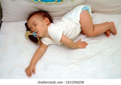 Rio de Janeiro, Brazil, January 27, 2007. Baby sleeping with pacifier in the cradle of your room