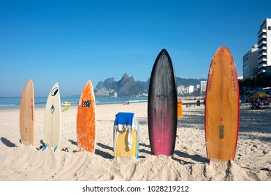 Rio de Janeiro, Brazil - July 24, 2016: Surfboards standing upright in bright sun on the Ipanema beach