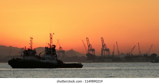 RIO DE JANEIRO, Brazil   July 18th, 2018  - general view with tugboats of the Rio de Janeiro' seaport at the sunset