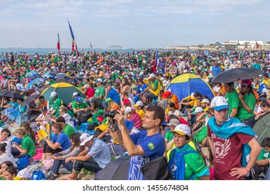 Rio de Janeiro, Brazil - July 28, 2013: At the World Youth Day 2013, people gather to attend Pope Francis Mass at Copacabana Beach
