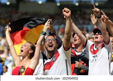 RIO DE JANEIRO, BRAZIL - JULY 04, 2014: Soccer fans of Germany during the World Cup Quarter-finals game between France and Germany in the Estadio Maracana. NO USE IN BRAZIL.