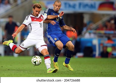 RIO DE JANEIRO, BRAZIL - July 13, 2014: Mascherano of Argentina and Goetze of Germany compete for the ball during the World Cup Final game at Maracana Stadium. NO USE IN BRAZIL.