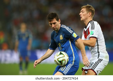 RIO DE JANEIRO, BRAZIL - July 13, 2014: Messi of Argentina and Kroos of Germany compete for the ball during the World Cup Final game between Argentina and Germany at Maracana Stadium. NO USE IN BRAZIL