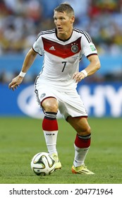 RIO DE JANEIRO, BRAZIL - July 13, 2014: Schweinsteiger of Germany kicks the ball during the 2014 World Cup Final game between Argentina and Germany at Maracana Stadium. NO USE IN BRAZIL.
