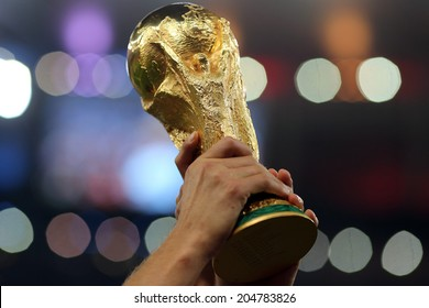 RIO DE JANEIRO, BRAZIL - July 13, 2014: The World Cup Trophy is lifted during celebrations after the 2014 World Cup Final game between Argentina and Germany at Maracana Stadium. NO USE IN BRAZIL.