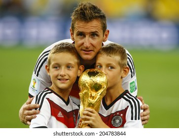 RIO DE JANEIRO, BRAZIL - July 13, 2014: Klose of Germany celebrate with the Trophy winning the 2014 World Cup Final game between Argentina and Germany at Maracana Stadium. NO USE IN BRAZIL.