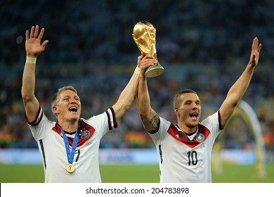 RIO DE JANEIRO, BRAZIL - July 13, 2014: Schweinsteiger and Podolski of Germany celebrate winning the 2014 World Cup Final game between Argentina and Germany at Maracana Stadium. NO USE IN BRAZIL.