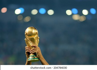 RIO DE JANEIRO, BRAZIL - July 13, 2014: The World Cup Trophy is lifted during the celebrations after the 2014 World Cup Final game between Argentina and Germany at Maracana Stadium. NO USE IN BRAZIL.