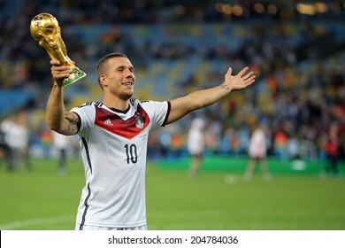 RIO DE JANEIRO, BRAZIL - July 13, 2014: Podolski of Germany celebrates with the Trophy winning the 2014 World Cup Final game between Argentina and Germany at Maracana Stadium. NO USE IN BRAZIL.