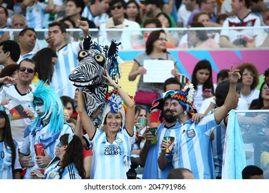 RIO DE JANEIRO, BRAZIL - July 13, 2014: Soccer fans during the World Cup Final game between Argentina and Germany at Maracana Stadium. NO USE IN BRAZIL