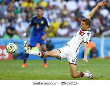 RIO DE JANEIRO, BRAZIL - July 13, 2014: Muller of Germany competes for the ball during the 2014 World Cup Final game between Argentina and Germany at Maracana Stadium. NO USE IN BRAZIL.