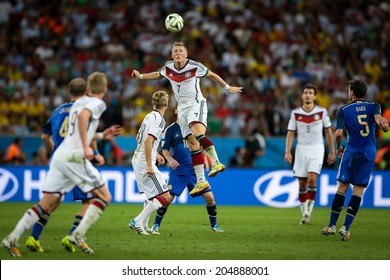RIO DE JANEIRO, BRAZIL - July 13, 2014: German players compete for the ball during the 2014 World Cup Final game against Argentina at Maracana Stadium. NO USE IN BRAZIL.