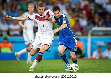 RIO DE JANEIRO, BRAZIL - July 13, 2014: Schweinsteiger of Germany and Messi of Argentina during the World Cup Final game between Argentina and Germany at Maracana Stadium. NO USE IN BRAZIL.