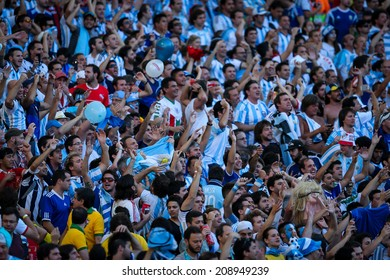 RIO DE JANEIRO, BRAZIL - July 13, 2014: Soccer fans during the World Cup Final game between Argentina and Germany at Maracana Stadium. NO USE IN BRAZIL.