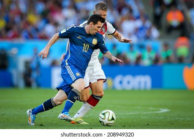 RIO DE JANEIRO, BRAZIL - July 13, 2014: Messi of Argentina competes for the ball during the World Cup Final game between Argentina and Germany at Maracana Stadium. NO USE IN BRAZIL.