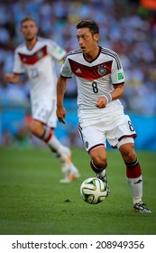 RIO DE JANEIRO, BRAZIL - July 13, 2014: Ozil of Germany competes for the ball during the World Cup Final game between Argentina and Germany at Maracana Stadium. NO USE IN BRAZIL.