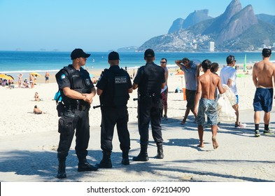 Rio de Janeiro, Brazil - July 24th, 2016: Police watch over tourists in Rio de Janeiro, Brazil. Rio is a popular tourist city but also experiences high levels of crime