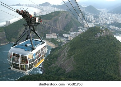 RIO DE JANEIRO, BRAZIL - JULY 16:  Tourists ride a cable car as it ascends up the summit of Sugar Loaf Mountain July 16, 2005 in Rio de Janeiro, Brazil.
