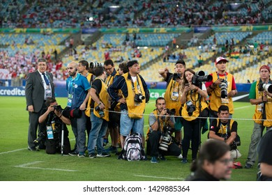 RIO DE JANEIRO, BRAZIL - June 18, 2019: group of photojournalists waiting for players to enter during the America Cup at the Maracana Stadium